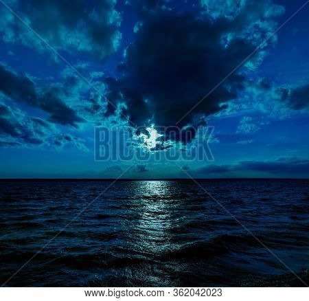 This Photo Illustration Of A Deep Blue Moonlit Ocean At Night With Calm Waves Would Make A Great Tra