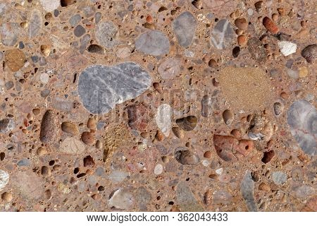 Surface Of A Conglomerate From The Alps In Southern Germany, So Called Nagelfluh