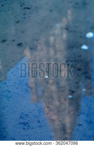 Abstract Reflection In Water Puddle On Cobblestone Street Of Notre-dame De Strasbourg Cathedral Of O