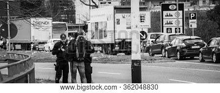 Kehl, Germany - Mar 16, 2020: Black And White Image Of Polizei Officers Inspect Travel Permit People