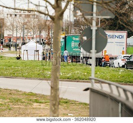 Kehl, Germany - Mar 16, 2020: Wide View Of German Polizei Police Officers Checks People Trucks Cars