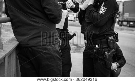 Black And White Image Of Unrecognizable German Polizei Police Officers Checks People At The Border C