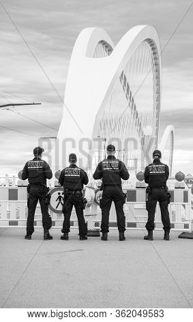 Black And White Image Of Unrecognizable German Polizei Police Officers Checks Traffic At Border Cros