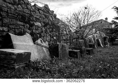 Abandoned Cemetery Old Cement Gravestones Placed All Around.