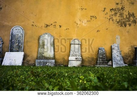 Abandoned Cemetery With Old Cement Gravestones All Around