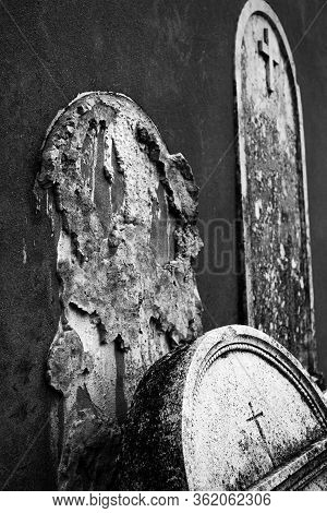 Abandoned Cemetery Old Cement Gravestones That Fell From The Wall.