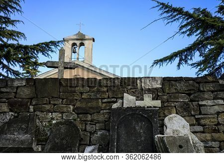 Broken Gravestones With The Church In The Back.