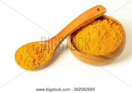 Healing Spice Turmeric Powder In Wooden Spoon And In Wooden Bowl On The White Backgorund Isolated. A