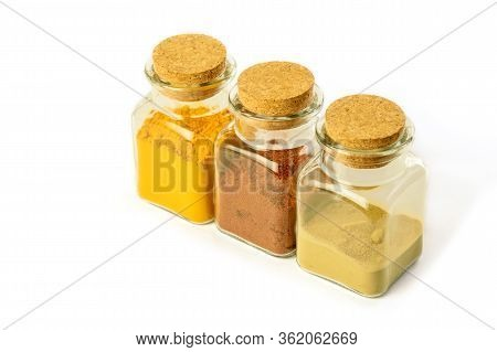 Glass Bottles With Spices On The White Background Isolated. Turmeric Powder, Hot Red Pepper Powder A