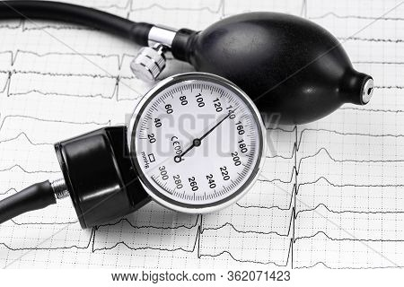 Tonometer, Device For Measuring Blood Pressure, Cardiogram On A White Background. Blood Pressure 140