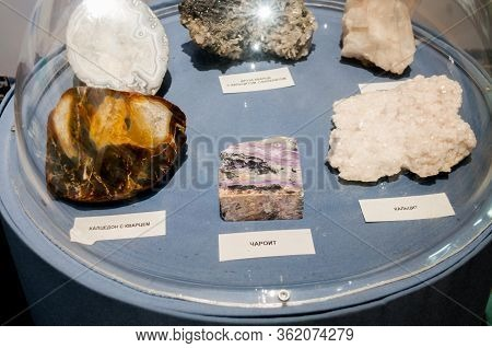 Russia, Blagoveshchensk, July 2019: Charoite, Calcite, Chalcedony With Quartz, Stones In The Amur Re