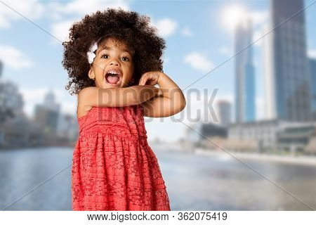Childhood And People Concept-cheerful Happy African American Little Girl Over Blurred Melbourne City