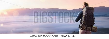 Happy Man in the Mountains Looking at the Sunset. Tourist in Mountain Peak. Travel Concept