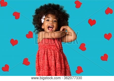 Portrait Of Cheerful Happy African American Little Girl, Over Colored Background With Hearts