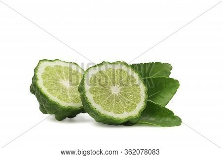 Cross Section Or A Half Bergamot Or Kaffir On White Isolated Background With Clipping Path. Bergamot