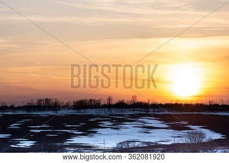 Early Spring. Landscape Of Early Spring, Snow Begins To Melt, Fields Open, Days Become Clear. Sunset