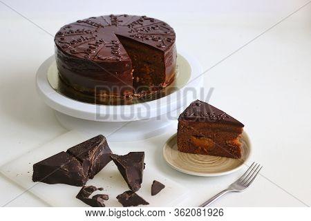 Chocolate Austrian Cake Sacher Sliced On White Table Background. Sacher Cake Slice. Traditional Aust