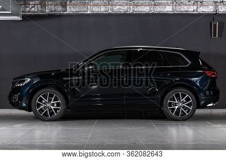 Novosibirsk/ Russia - March 09 2020: Volkswagen Touareg, Off-road Car, Side View. New Black  Modern