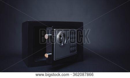 Cash Money Safe Deposit. Symbol Of Money Safety. Small Residential Vault In Dark Background. Toned S