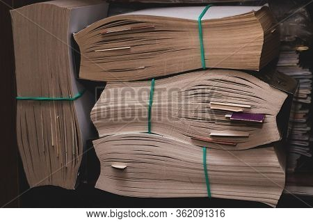 Books With Soft Cover. Paperback Close Up. Book Edge Macro. Pages Pulled Together With An Elastic Ba