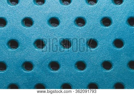 Holes In Plastic Plate. Abstract Pattern Background