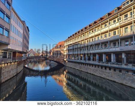 Nuremberg, Germany - January 01, 2020: View From River Pegnitz Bridge Museumsbruecke Towards Bridge