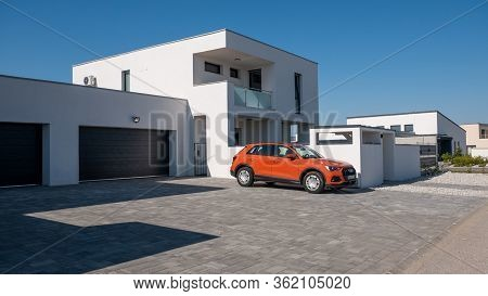 Gyor Hungary 04 07 2020: Modern Flat Roof House. In Front Of Him Is An Audi Q3 Car. Real Estate Busi