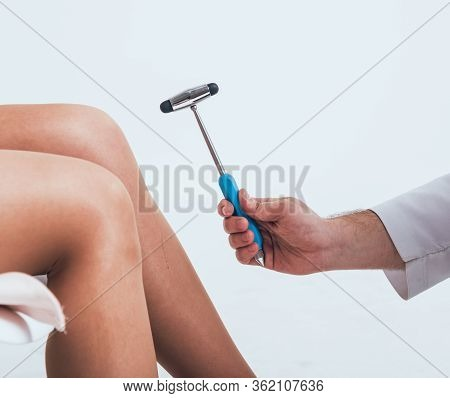 Orthopedic Surgeon Examining The Knee Reflex. The Doctor