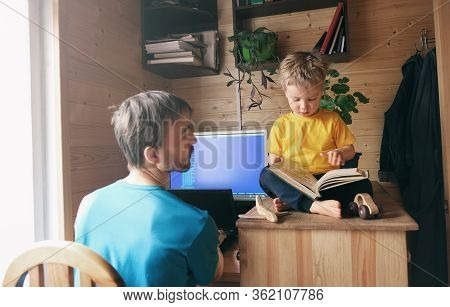Father Developer Freelancer Work From Home And Help Son Child To Read Book, Concept Of Self-isolated