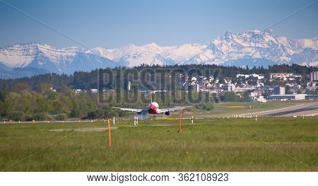 ZURICH - MAY 5: A-320 Air Berlin landing in Zurich airport after short haul flight on May 5, 2016 in Zurich, Switzerland.Zurich airport is home port for Swiss Air and one of the biggest european hubs.