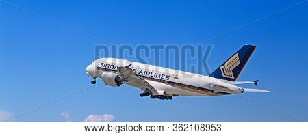 ZURICH - July 30:  A-380 Singapore Airlines taking off at Terminal A of Zurich Airport on July 30, 2016 in Zurich, Switzerland. Zurich airport is home port for Swiss Air and one of the european hubs.
