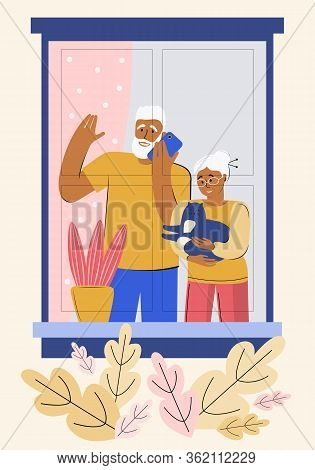 Older People Are Quarantined At Home. Stay At Home. An Elderly Man And Woman Look Out Of The Window