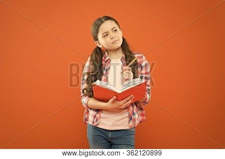 Study Language. Child Doing Homework Writing In Workbook. Girl Hold Book And Pen. Girl Cute Write Do