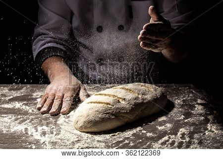 Baker Making Patterns On Raw Bread Using A Knife To Shape The Dough Prior To Baking. Manufacturing P
