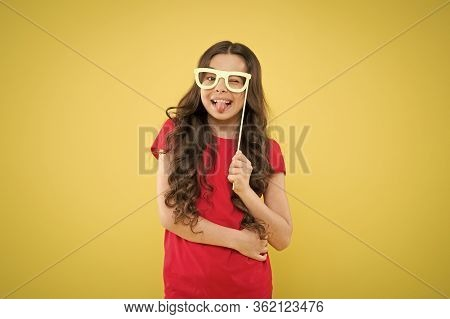 Funny Small Girl Holding Glasses Photo Booth Props On Stick. Cute Kid With Fancy Party Props. Party