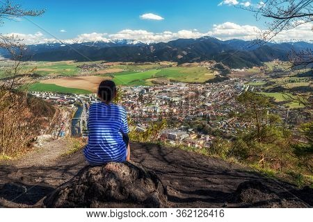 Lonely Boy Sitting On Top Of The Hill Cebrat And Looking At Town Ruzomberok, Slovakia