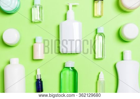 Group Of Plastic Bodycare Bottle Flat Lay Composition With Cosmetic Products On Green Background Emp