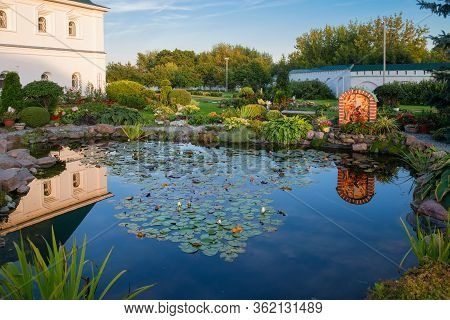 Murom, Russia - August 24, 2019:  Beautiful Landscaped Garden Pond With Blooming Water Lilies In Tra