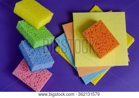 Kitchen Napkins And Sponges On A Blue Background. Set Of Multi-colored Napkins And Kitchen Sponges.