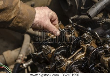Checking The Thermal Clearances Of The Intake Valves Of The Gasoline Engine. An Elderly Mechanic Che