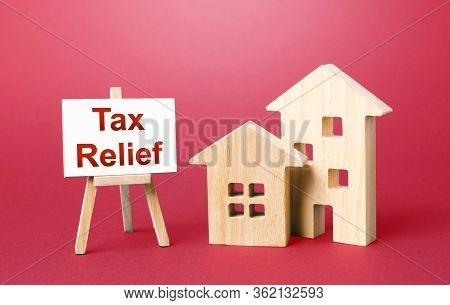 Residential Houses And Tax Relief Easel. Deferral Payments Of Taxes And Debts. Financial Flexibility