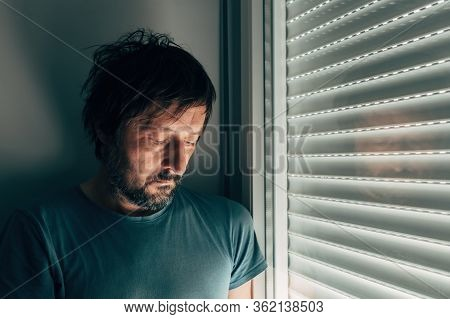 Sulking Man By The Window With Shutters Rolled Down, Portrait Of Disappointed Male Person