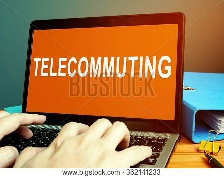 Telecommuting Word On The Laptop Screen. Work At Home Concept.