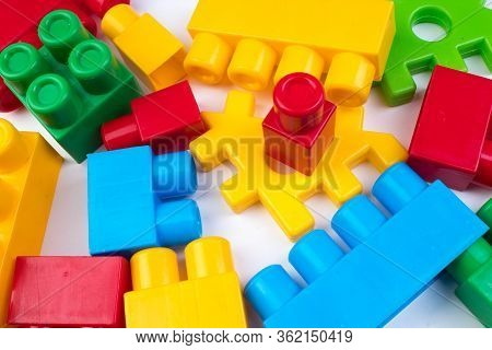 Lot Of Colorful Rainbow Toy Bricks Background. Educational Toy For Children Isolated On White Backgr