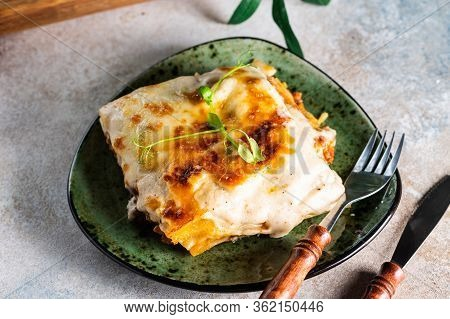 Piece Of Tasty Hot Lasagna With Red Wine. Small Depth Of Field. Traditional Italian Lasagna. Portion