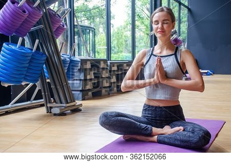 Young Attractive Woman Practicing Yoga With Closed Eyes Relaxing, Sitting In Padmasana Exercise, Pra