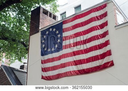 13 star American flag on the exterior of the Betsy Ross House on Arch Street in Philadelphia, Pennsylvania on July 6, 2019.