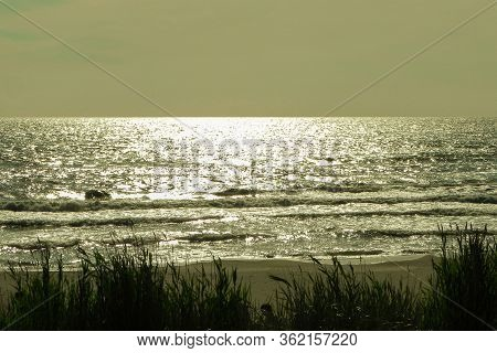 Sunlights Glimmer On The Shore Of The Serene Sea In Evening