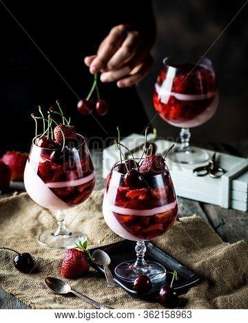 Milk Dessert With Cherry And Strawberry. Milk Jelly. Yougurt Dessert. Raw Food. Panna Cotta. Strawbe