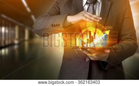 Business People Hold A Tablet, Plan And Strategy And Display Virtual Holograms Of Statistics, Financ